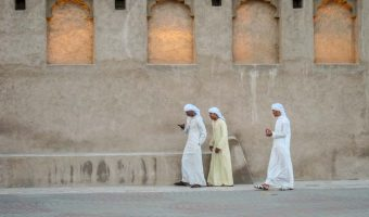 Men walking outside Sheikh Saeed Al Maktoum House