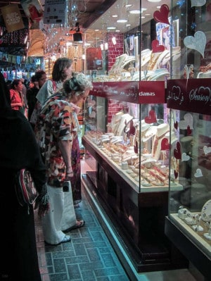 Women looking through the window of a shop at the Gold Souk in Dubai