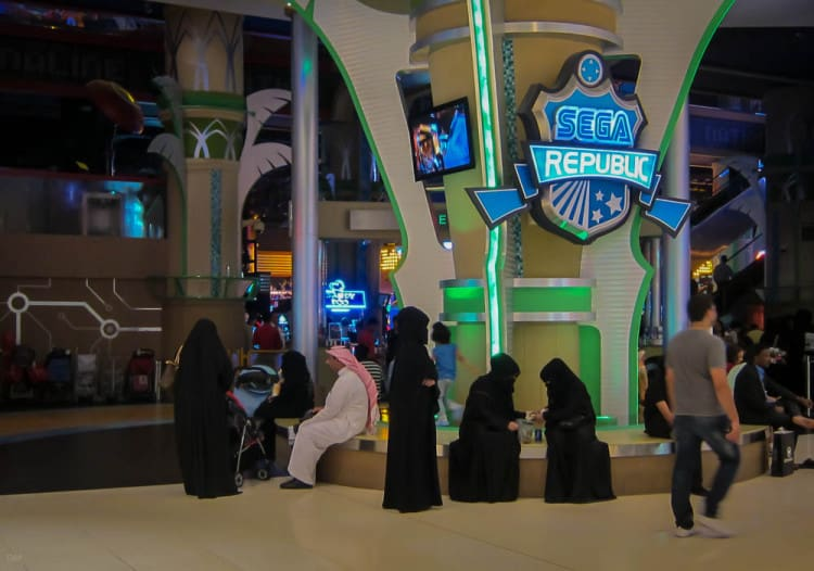 Arab family waiting outside the entrance to the Sega Republic theme park at the Dubai Mall