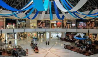 Large atrium at the Dubai Marina Mall with shops and cafes