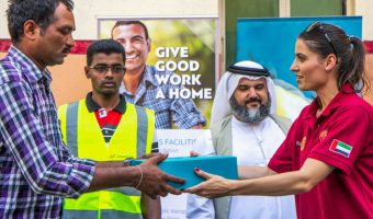 Food package being given to a worker in Dubai during Ramadan