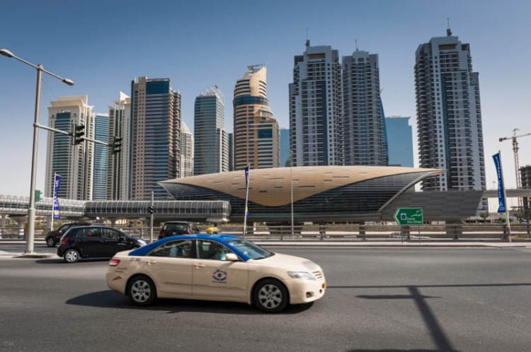 Taxi passing a Metro station on Sheikh Zayed Road in Dubai