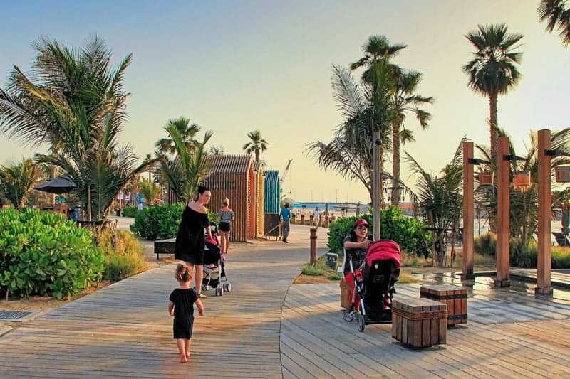 Boardwalk, showers, and day rooms at La Mer, Dubai