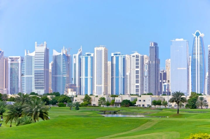 View of the golf course at Emirates Hills with Jumeirah Lakes Towers in the background