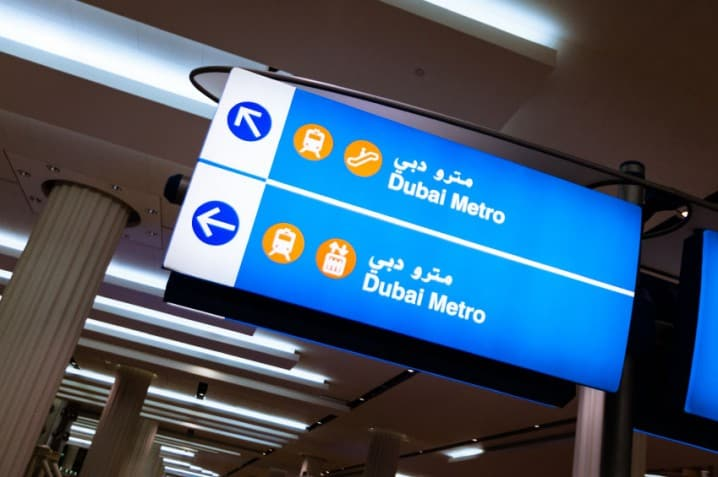 Dubai Metro sign giving directions in both Arabic and English languages
